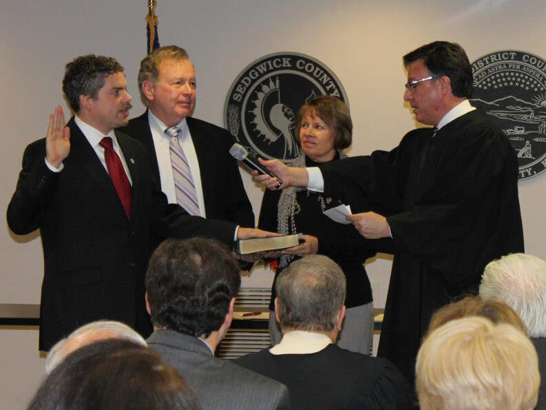 Kelly taking the oath of office for Sedgwick County Clerk